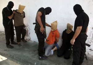 "Hamas executes ""collaborators"""