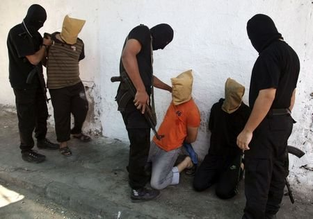 "Hamas executes ""collaborators"""